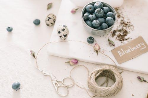 Blueberries In A Bowl Beside Art Materials