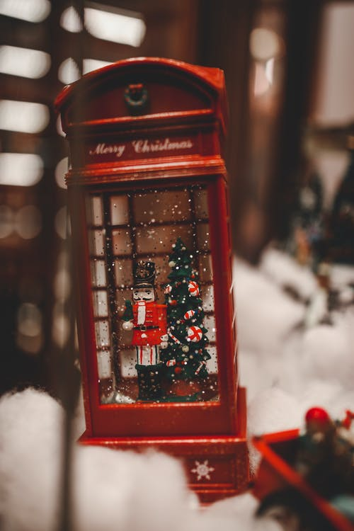 Christmas toy telephone booth placed on table