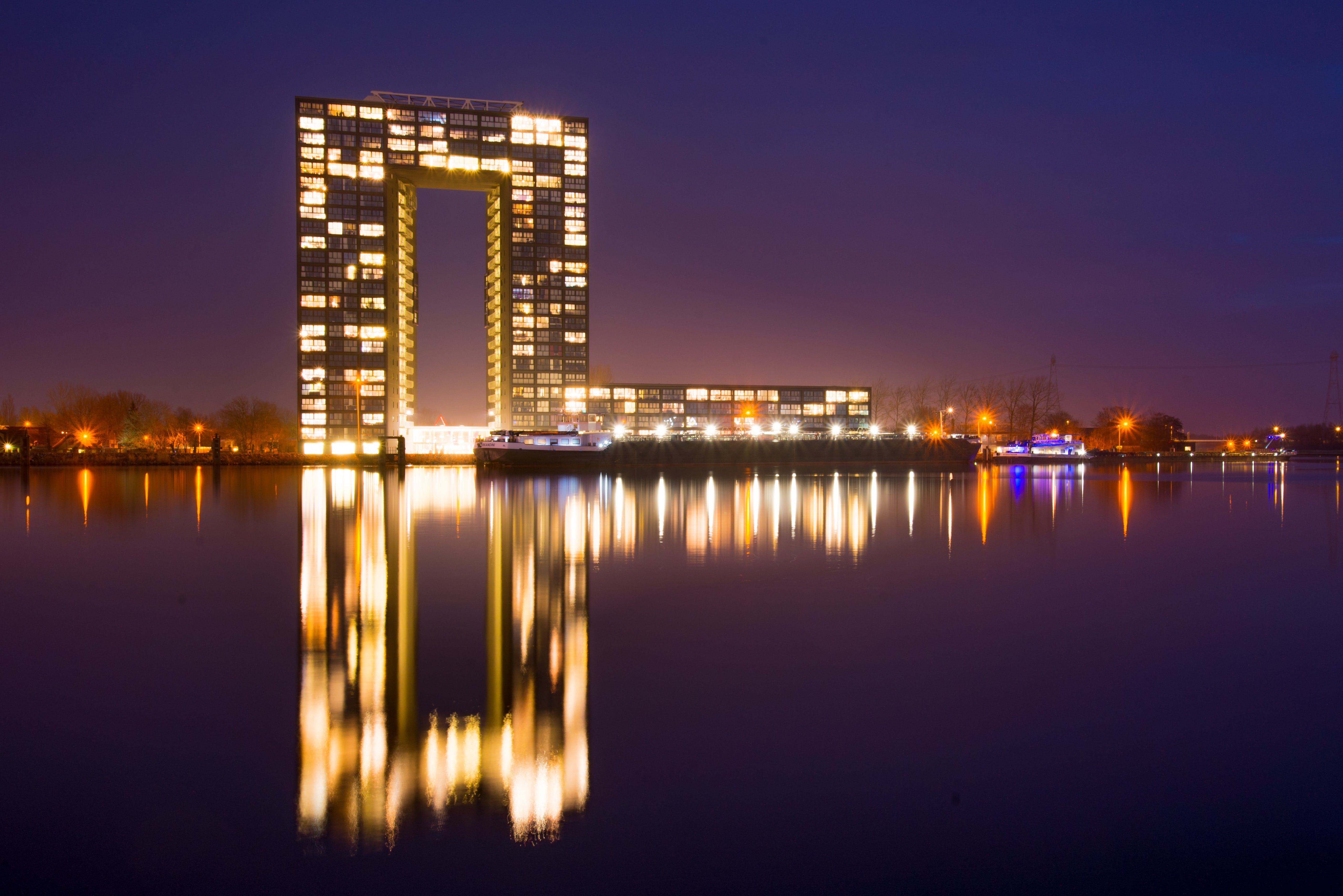 City Building Near Body of Water during Nighttime