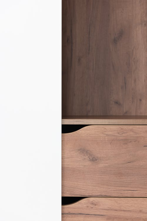 Modern wooden cabinet with drawers at home