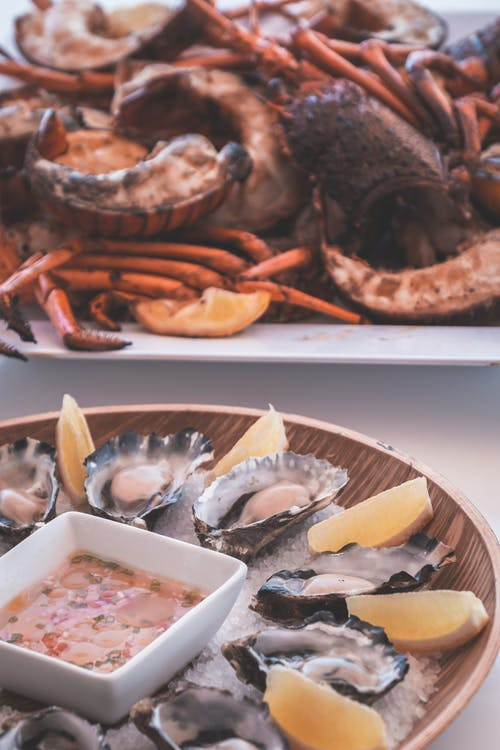 Tasty grilled lobsters and fresh oysters served on table in restaurant