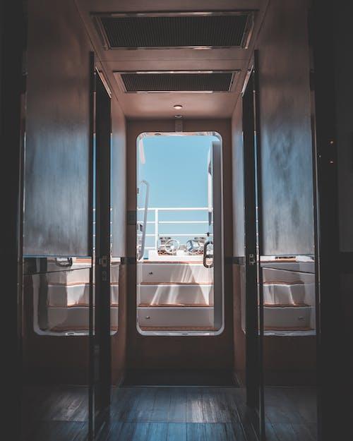 Narrow corridor in modern boat in daytime