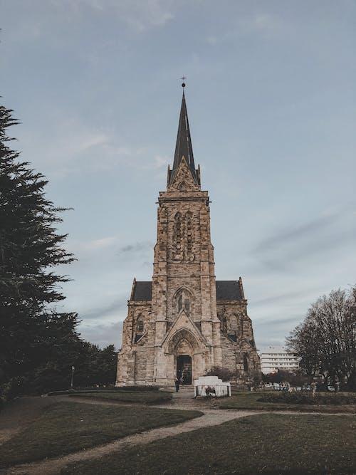 Brown Concrete Church Under Gloomy Sky