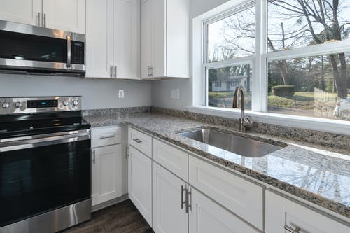 White Wooden Kitchen Cabinet With Stainless Steel Sink