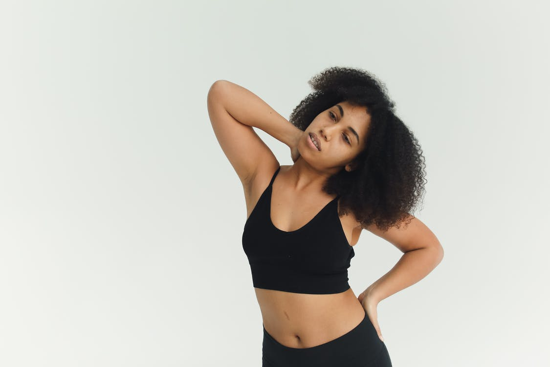 Woman in Black Sports Bra and Black Shorts