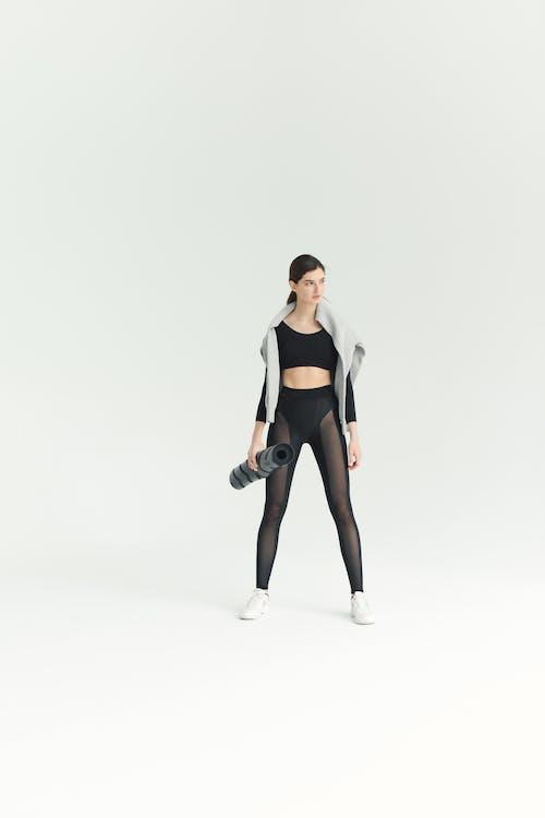 Woman in Black Sports Bra and Black Leggings