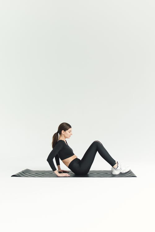 A Woman Sitting on the Mat
