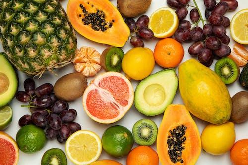 Sliced Orange Fruit and Green Fruit