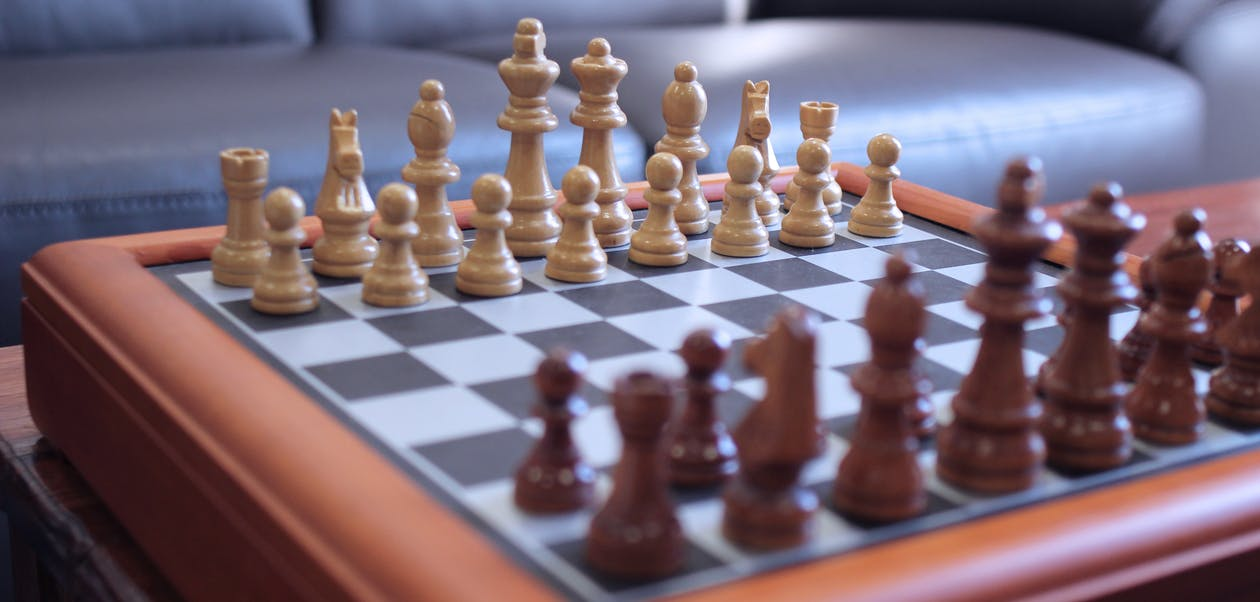 Brown,green, and White Chess Pieces