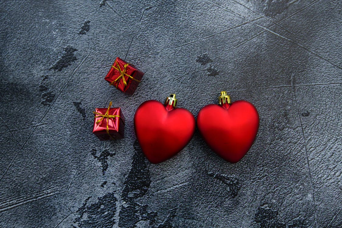 Decorative red hearts and gift boxes
