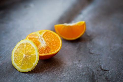 Sliced Orange Fruit on Gray Surface
