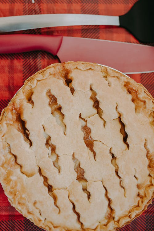 Brown Pie on Red Textile