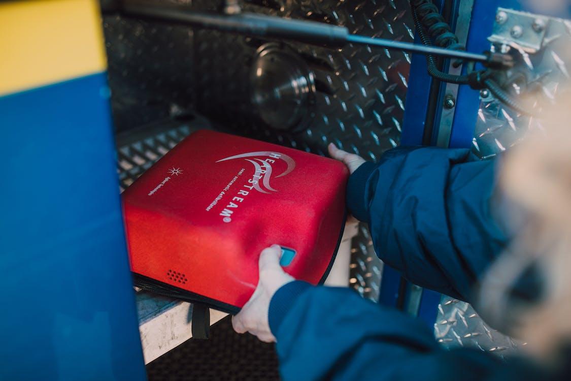 Person Getting a Defibrillator