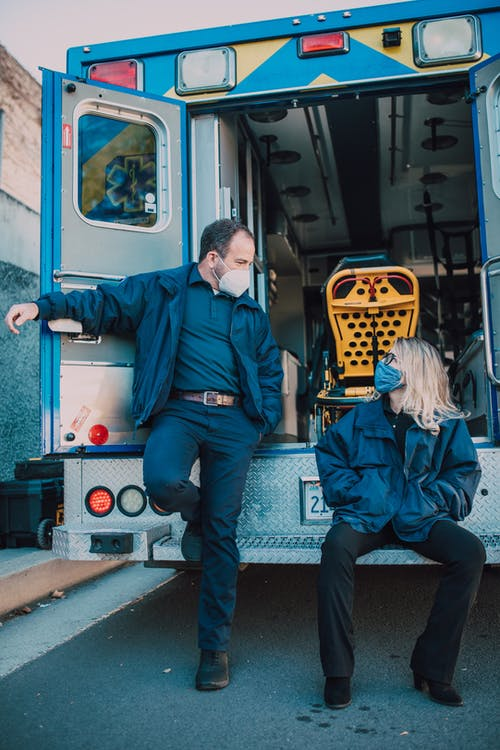 Paramedics at the Back of an Ambulance