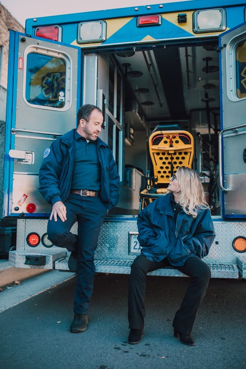 Paramedics Behind an Ambulance
