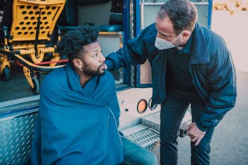 Paramedic Talking to a Man