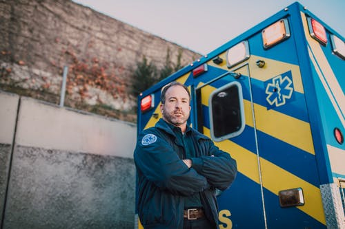 EMT Standing Behind an Ambulance