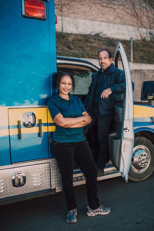 Paramedics Leaning on an Ambulance