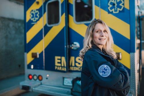 EMT Wearing a Blue Jacket