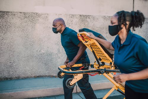 Paramedics Pulling a Stretcher