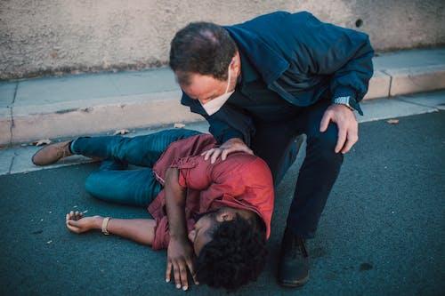 Paramedic Checking on a Man