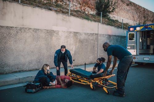 Paramedics Helping a Man on the Ground