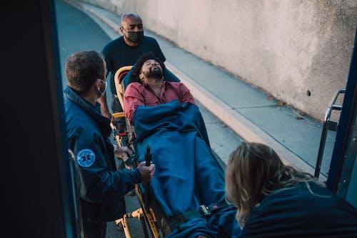 Paramedic Pushing Man on A Stretcher