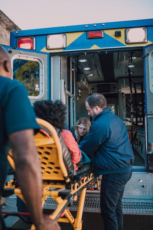 Paramedics Assisting a Patient on a Stretcher