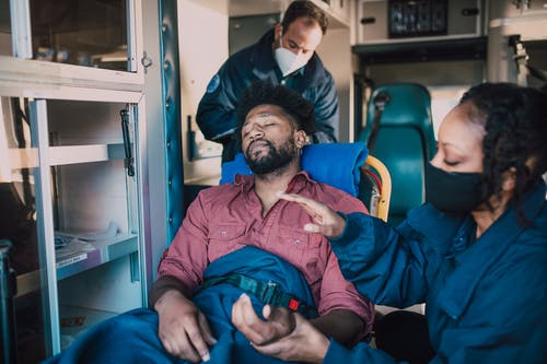 Paramedic Holding Man's Hand