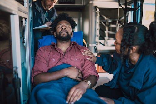 Paramedic Helping a Man