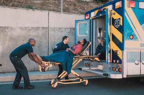 Paramedics Helping a Man on a Stretcher