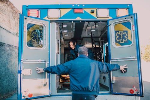 Man Opening Ambulance Door