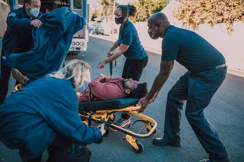 Paramedics Helping A Man