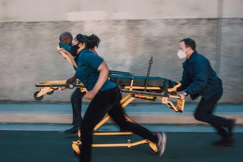 Paramedics Pushing A Stretcher