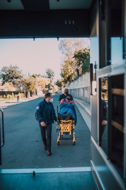 Paramedics Pushing Man On A Stretcher