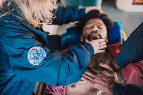 Paramedic Checking On Man