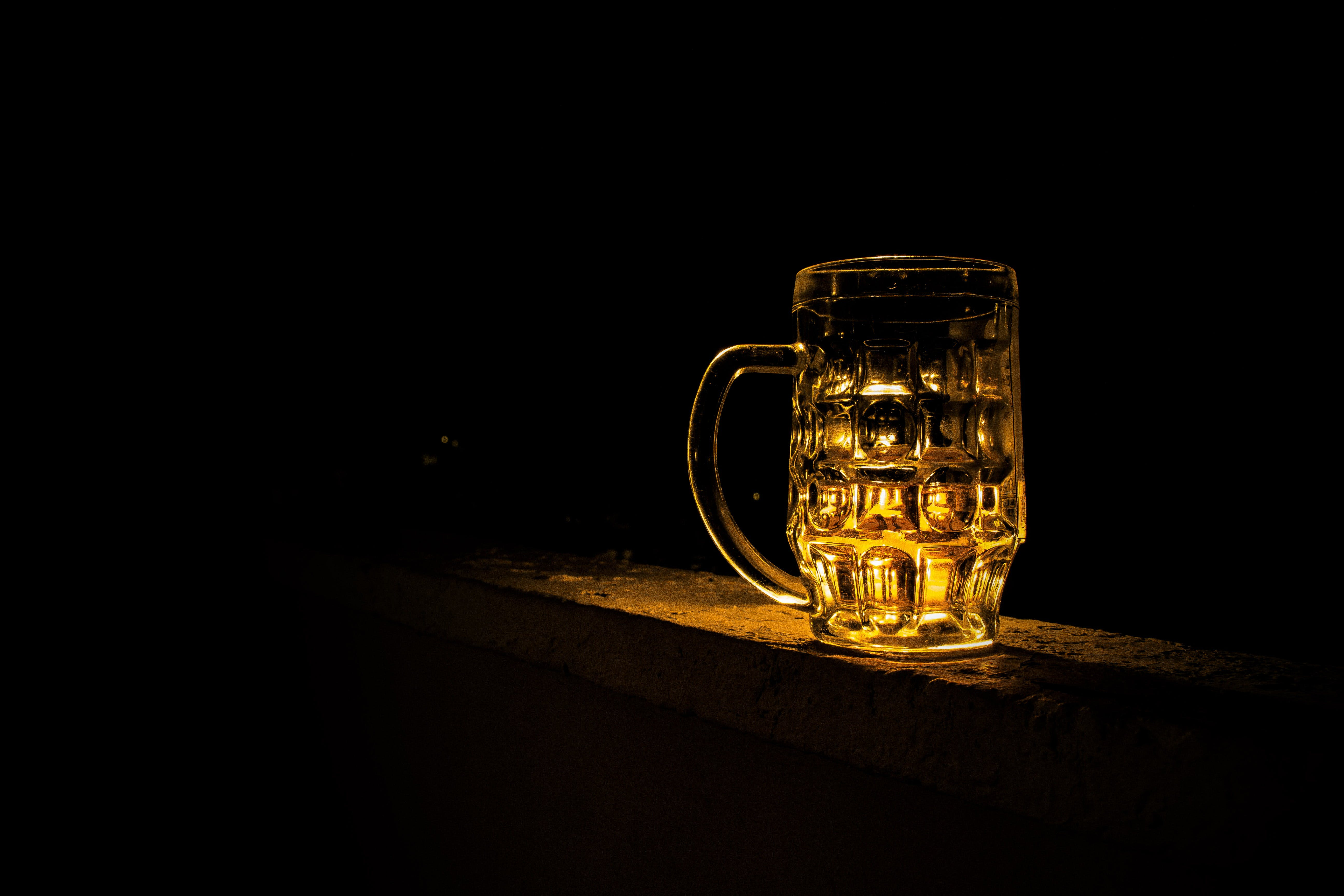 Clear Glass Mug With Beverage during Night Time