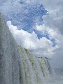 Waterfalls Under Blue Sky With White Clouds during Daytime