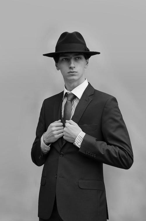 Man in Black Suit Jacket Wearing Black Hat