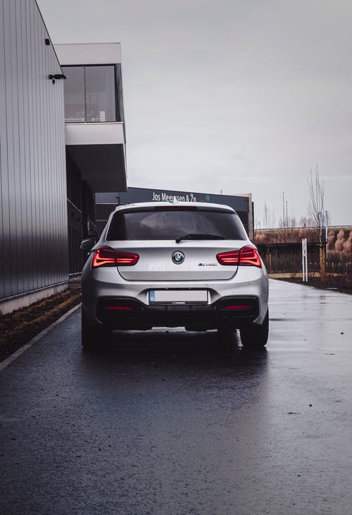 White Bmw X 6 Parked Beside White Wall