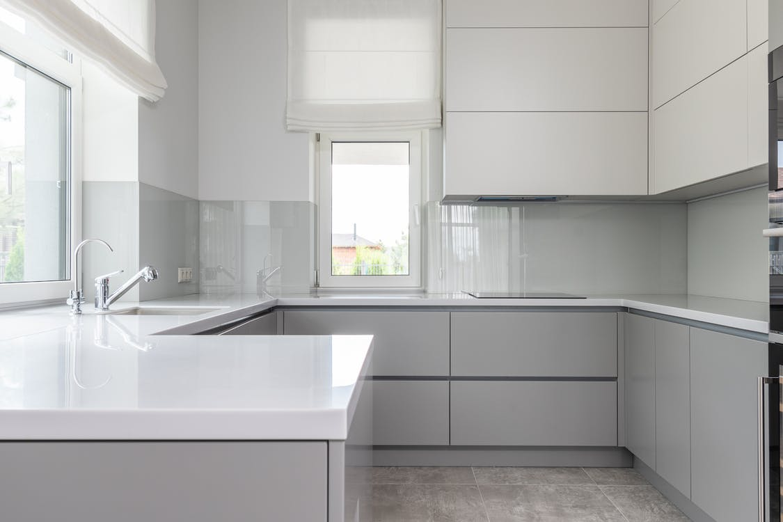 Contemporary kitchen with minimal white interior