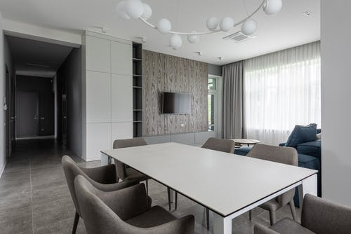 Modern lounge with white table and soft chairs
