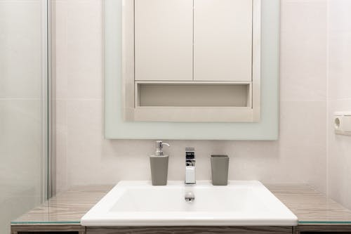 Interior of contemporary bathroom with white sink