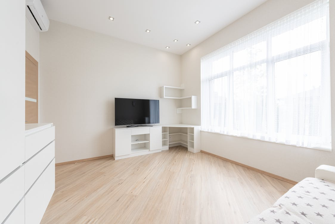 Spacious living room with TV set