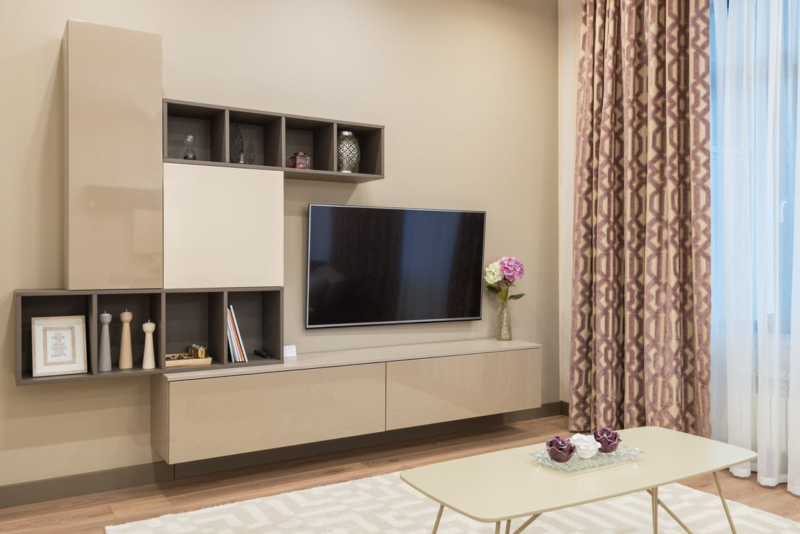 Modern furniture and TV set in cozy living room