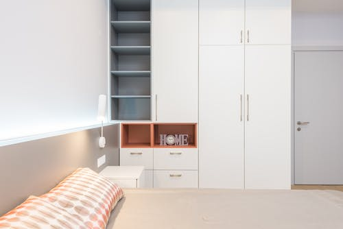 White Wooden Cabinet Beside White Wooden Cabinet