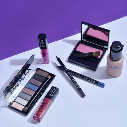 Cosmetic Products on White Surface