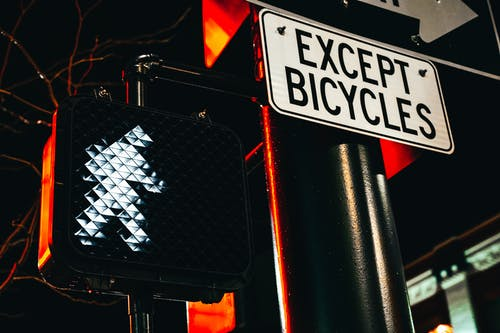 Except Bicycles road sign and traffic light at night