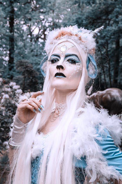 Woman in White and Gold Mask