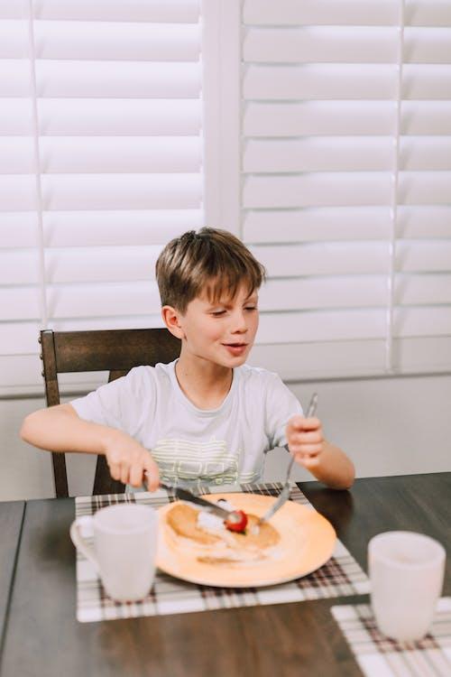 A Boy Eating Breakfast